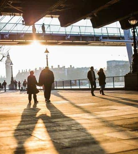 bridge city couple walking 34682