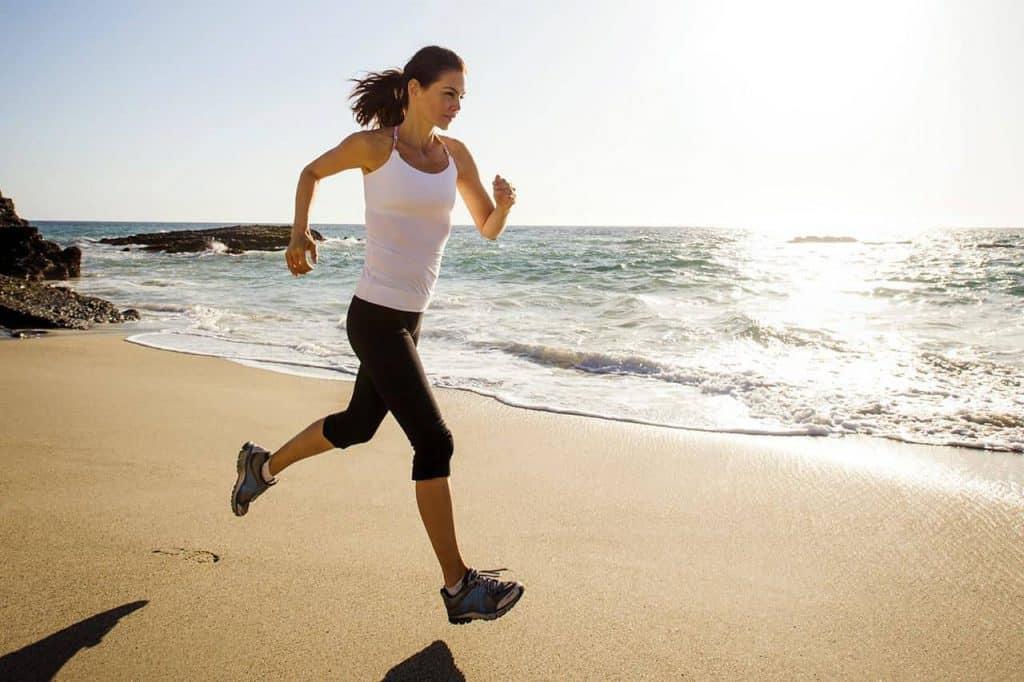 woman runs on the beach