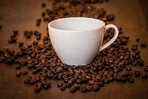 Coffee beans and a cup