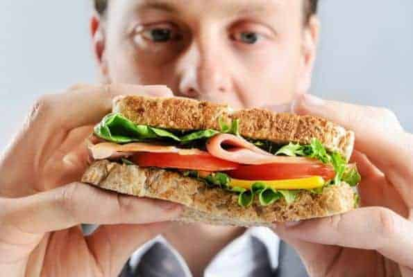 a man eats a sandwich