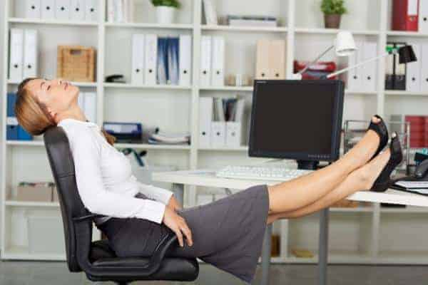 woman keeps her feet on the desk