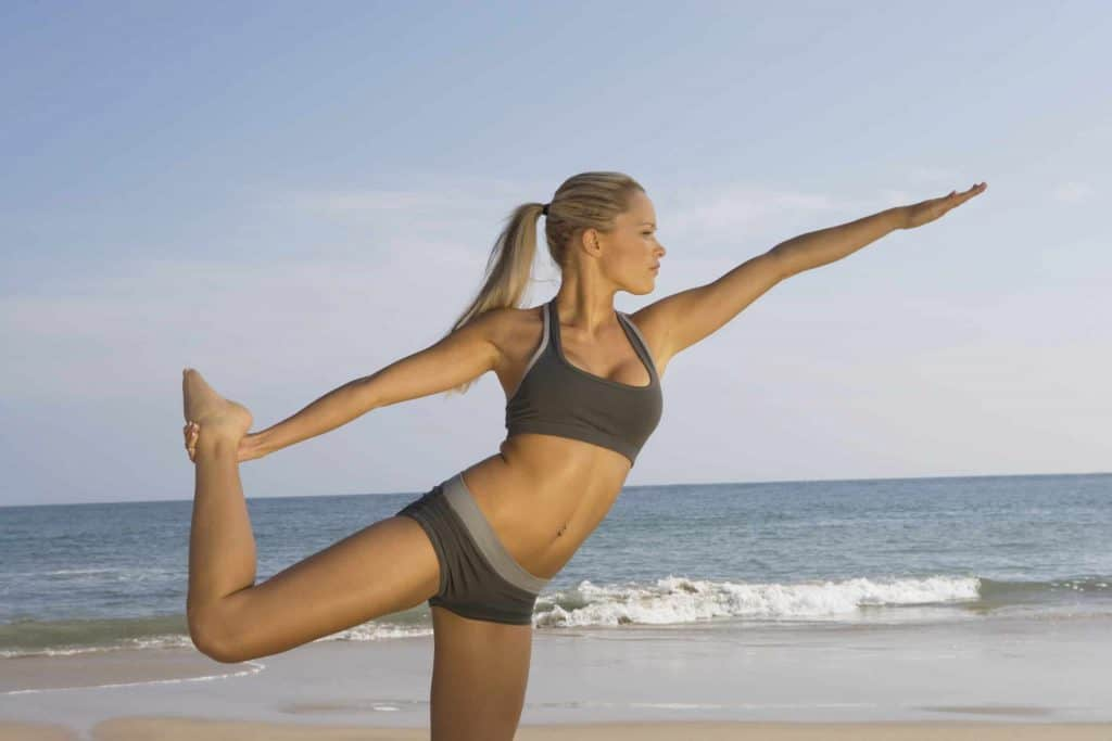 Young woman stretches before a morning run