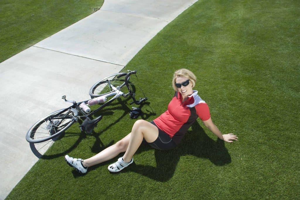 a woman sits next to a bike
