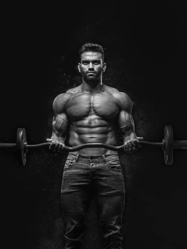 man lifts barbell