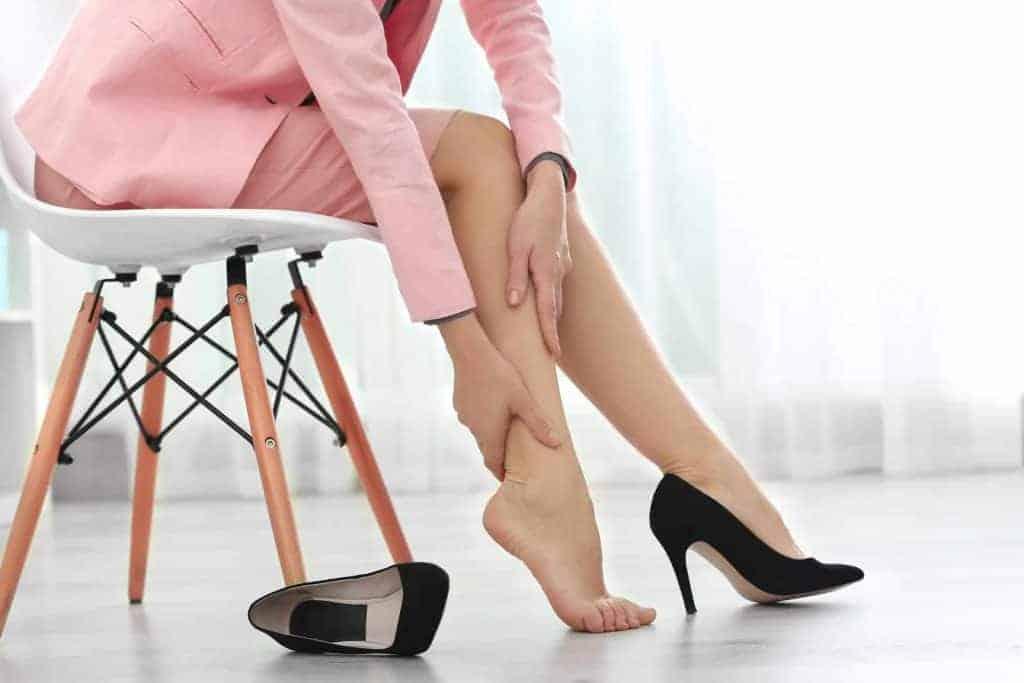 a woman massages her leg
