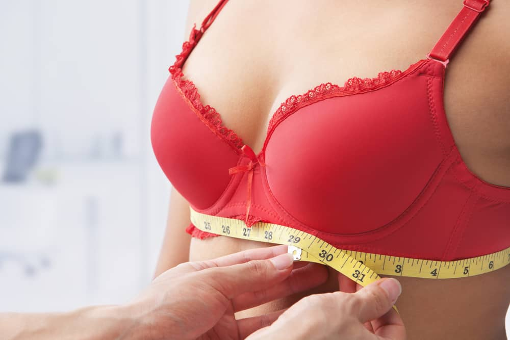 female breasts measured with a centimeter