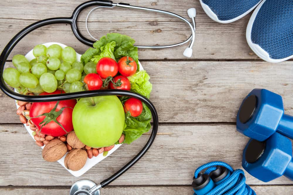 Fruit, dumbbells and a stethoscope