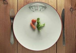 vegetables and cutlery on the scale