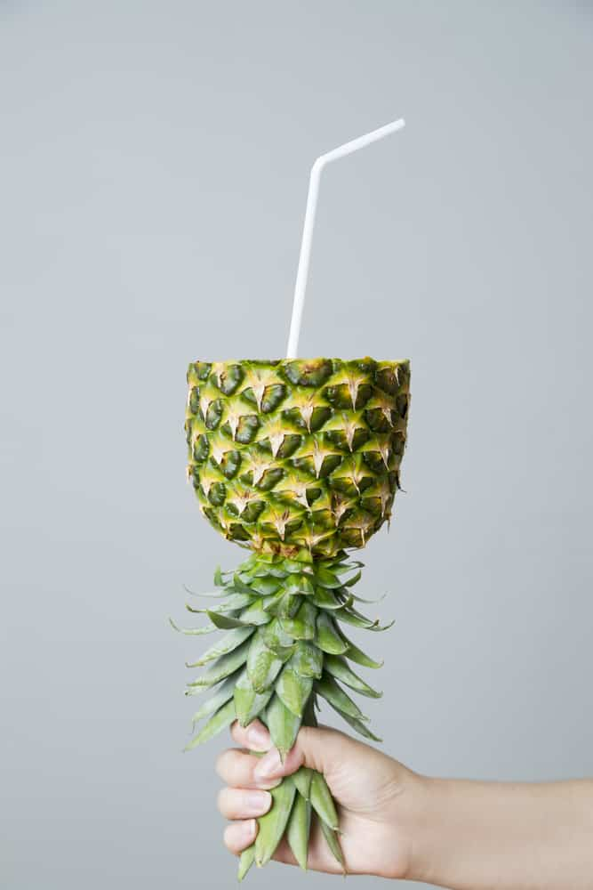 Pineapple with a straw